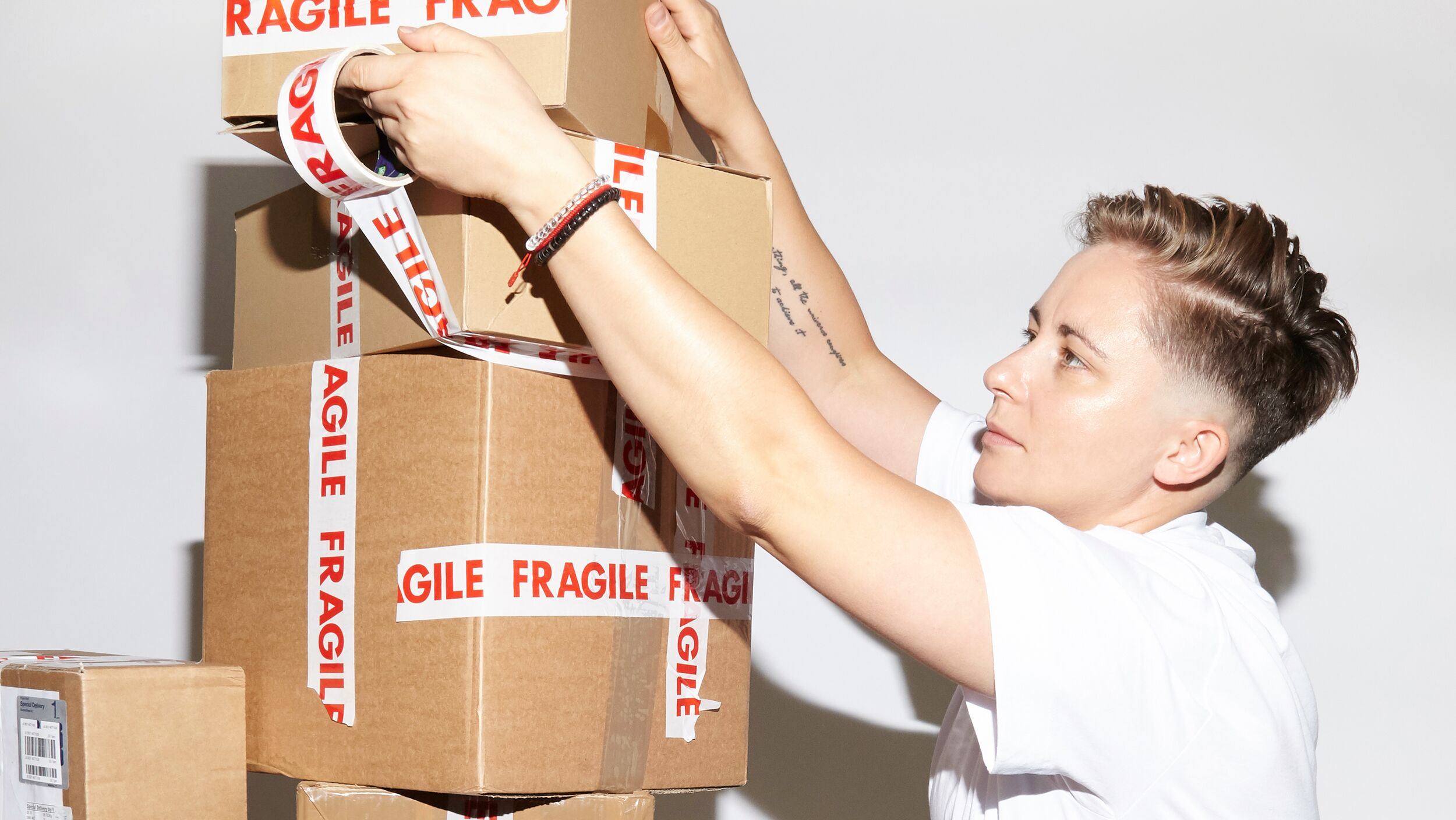 BEAUTY PIE Ops Manager Monika Muszal stacking boxes