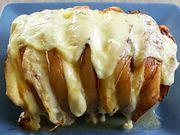 Recette : Rôti de porc au bacon et fromage à raclette - Recette au fromage