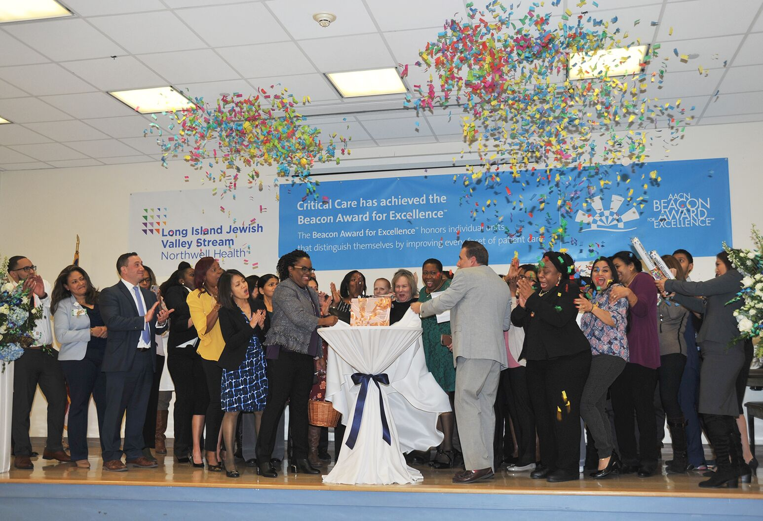 LIJ Valley Stream critical care unit staff celebrate Beacon Award recognition.