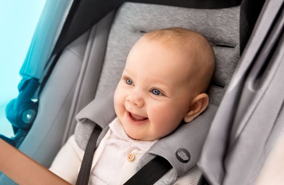 Bebe-Confort-Pushchair-Lila-Nomad-Grey-Smiling-in-harnass-920x600