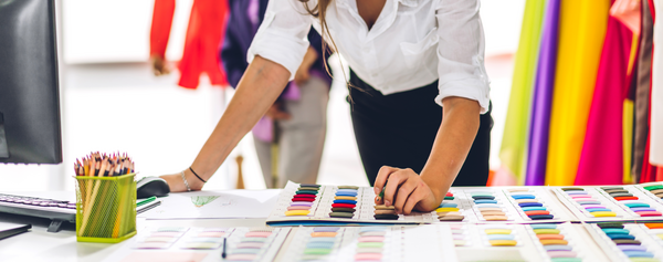 Woman choosing colors for fabrics