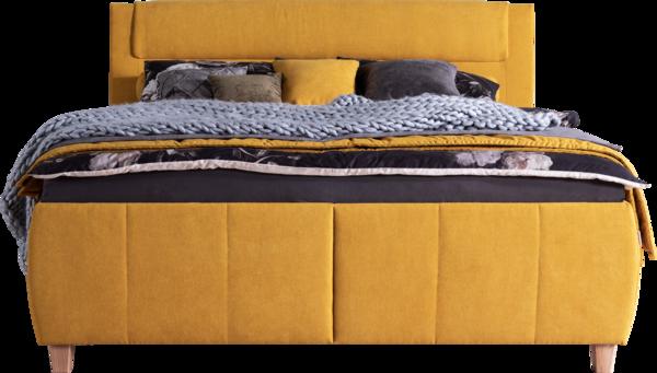 Bett in gelbem Stoff, Holzfüßen und Naht am Kopfhaupt