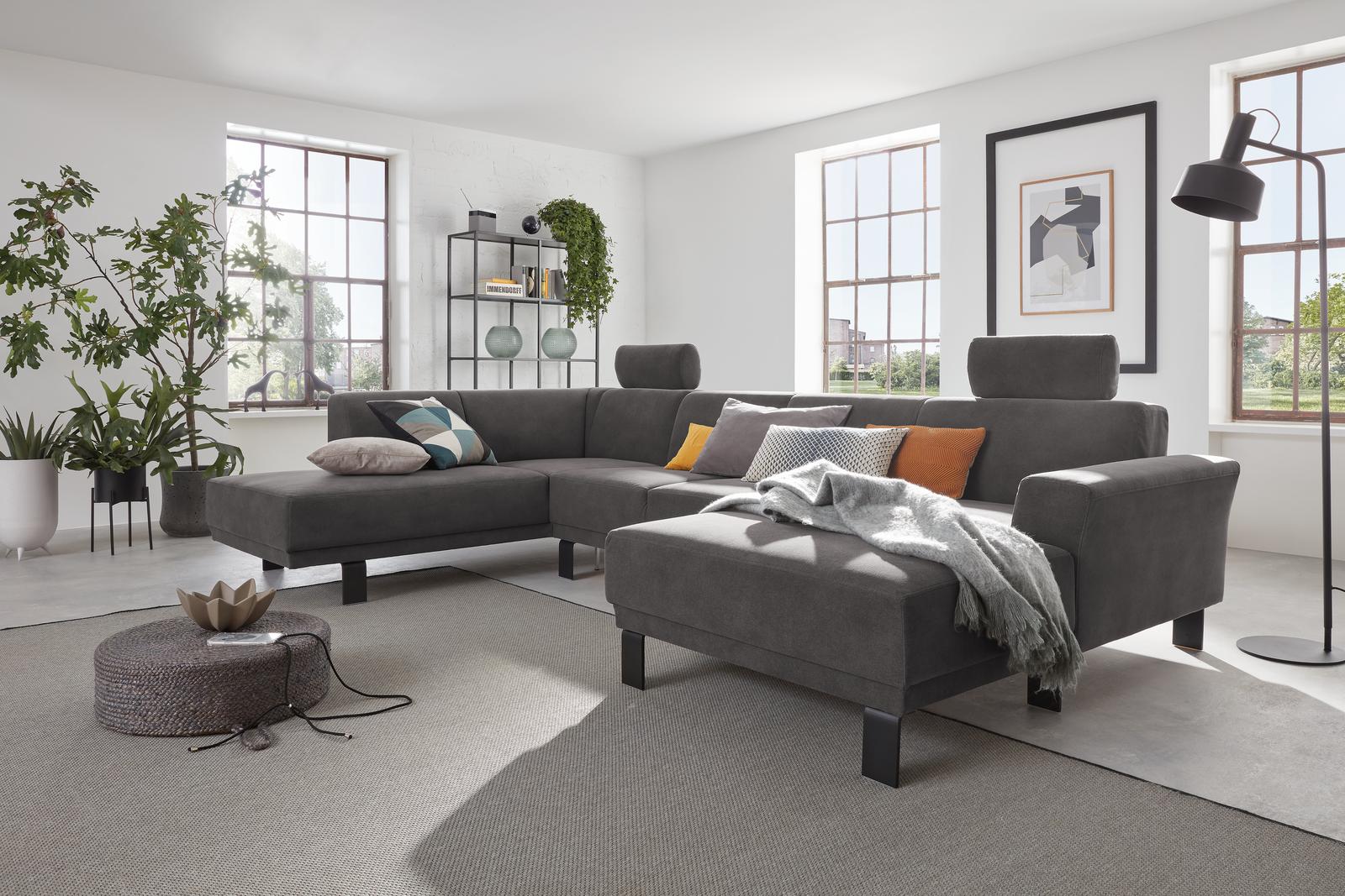 dunkelgraues Sofa mit Vorziehbank, verstellbarer Rückenlehne und schwarzen Metallfüßen