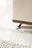 Boxspringbett in hellbeigem Stoff, Chromfüßen, Holzsockel und dekorativer Kopfteil-Steppung