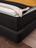 Detail Bettkasten mit dunkelgrauem Stoff und schwebende Optik