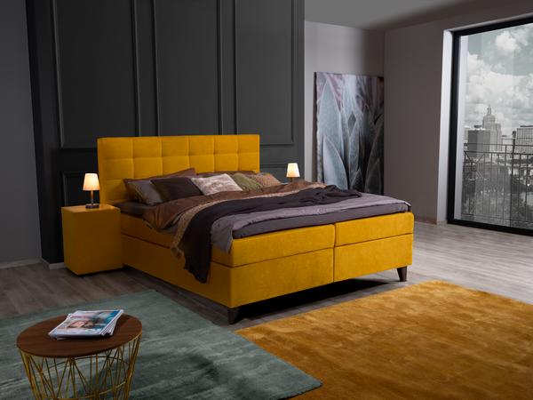 Bett Neomi mit gelben Stoff, schwarzen Holzfüßen und Quadratheftung im Kopfhaupt