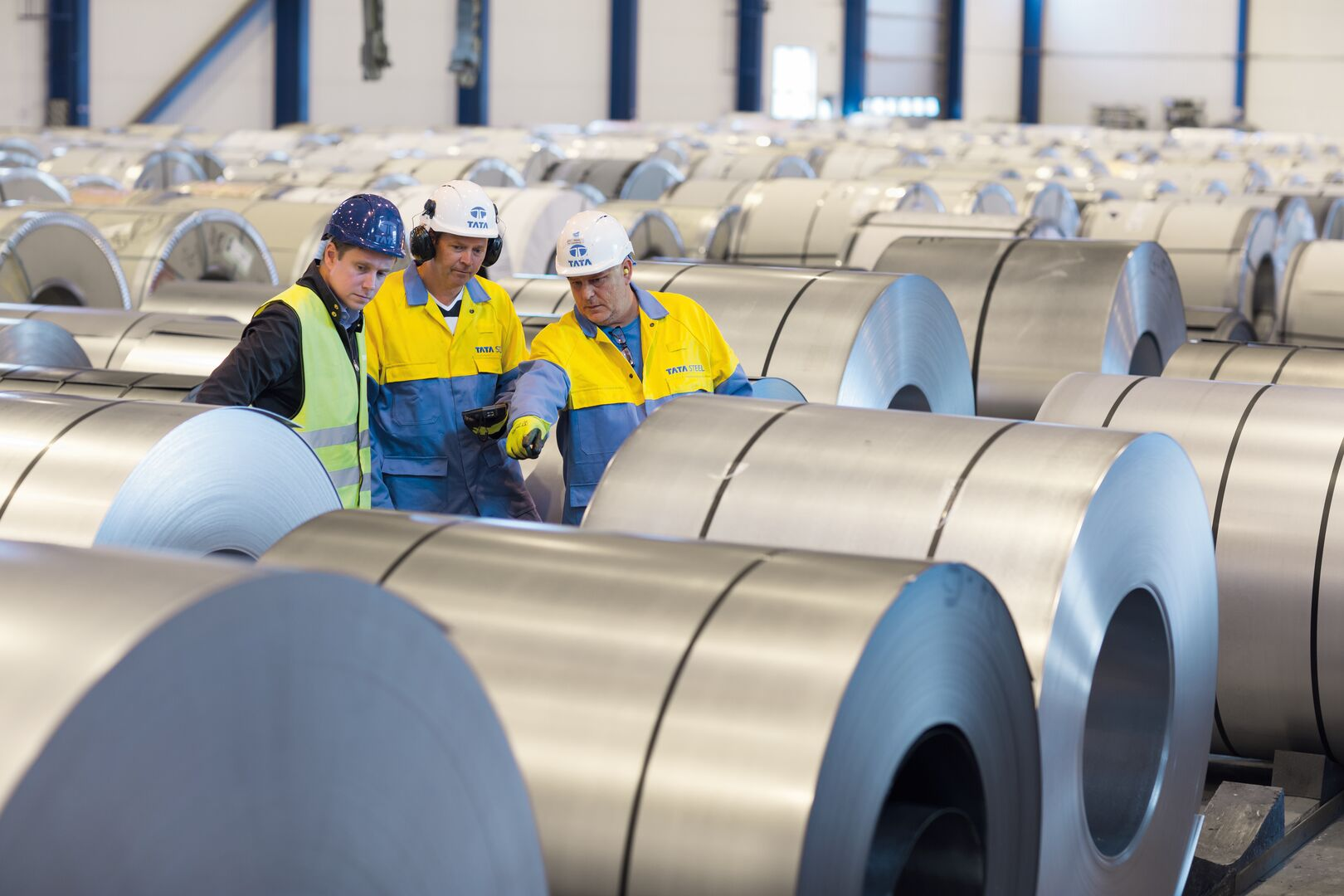 Tata Steel employees viewing coils at the distribution and processing centre in Halmstad