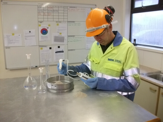 Tata Steel employee carrying out Shapfell lime quality testing in a lab environment