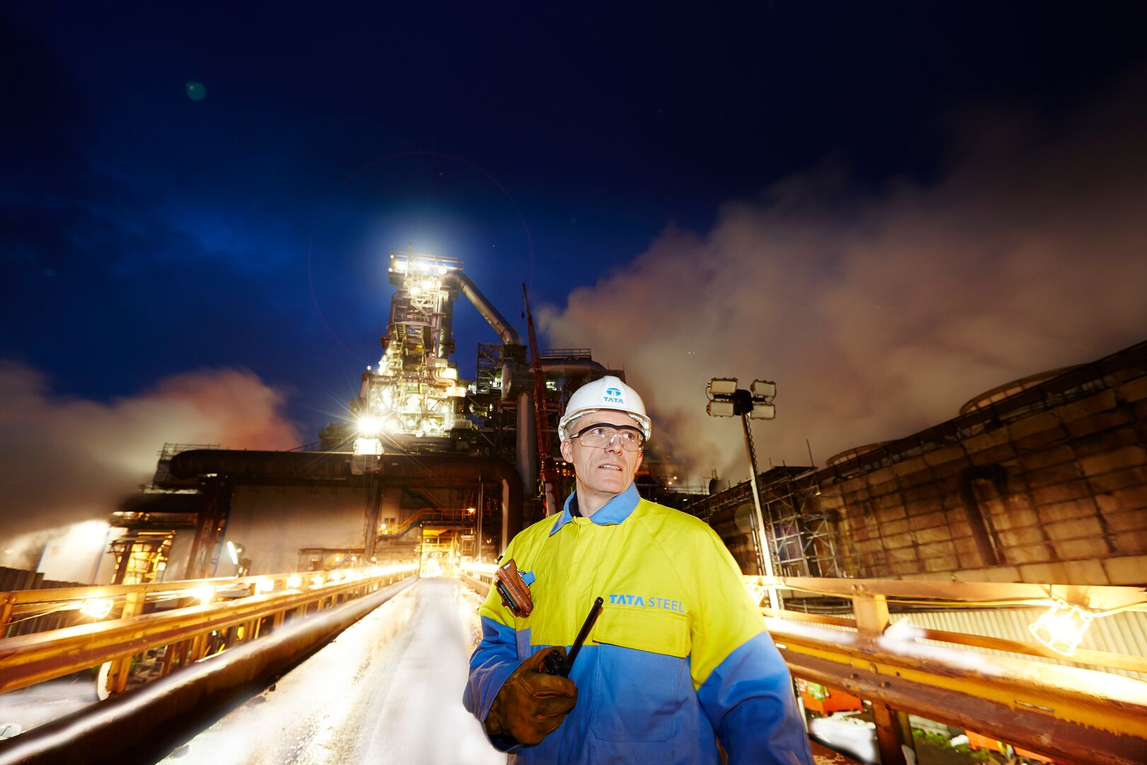 Tata Steel employee at Port Talbot site with blast furnace in the background