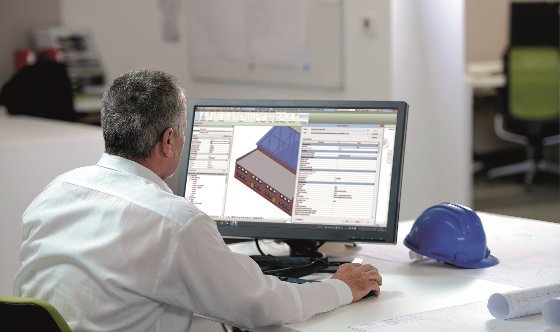 Man looking at screen with BIM models on