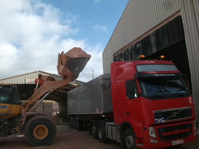Shapfell lime being loaded onto a lorry outside a manufacturing building