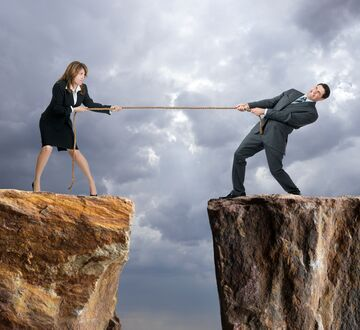 Illustration: man and woman on a mountain pulling a rope between them
