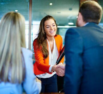 Woman handshaking under an interview