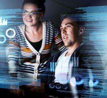 Bilde av to mennesker som ser på en dataillustrasjon