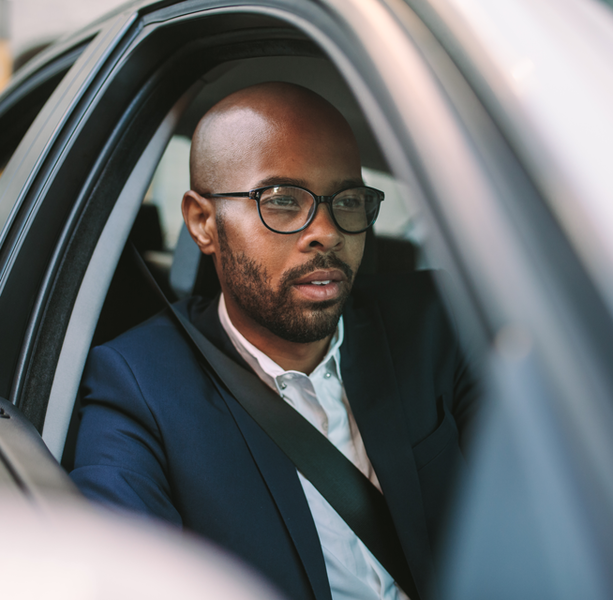 Businessman driving a car to office