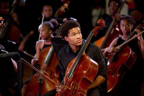 Young male musician from the Africa Utopia Orchestra performing at the Southbank Centre