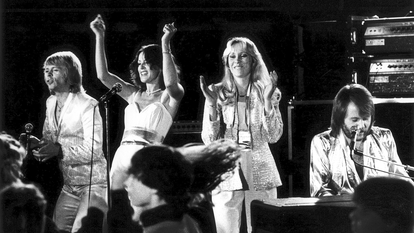Black and White image of ABBA performing on stage