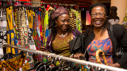 Two women laughing, Africa Utopia Marketplace