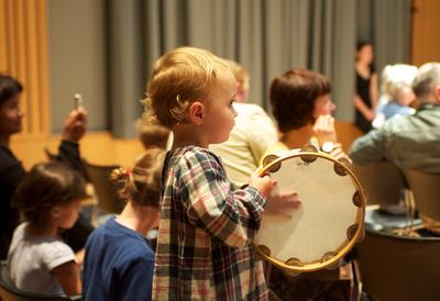 Baby with tambourine drum