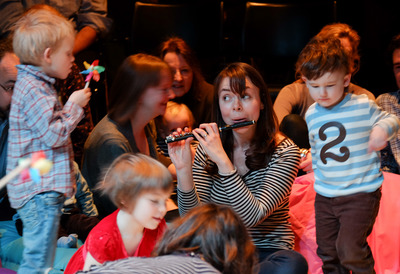 Children and adults enjoy a musical session