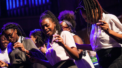 Celebrate Royal Greenwich Singing Spectacular, young people on  swaying on stage