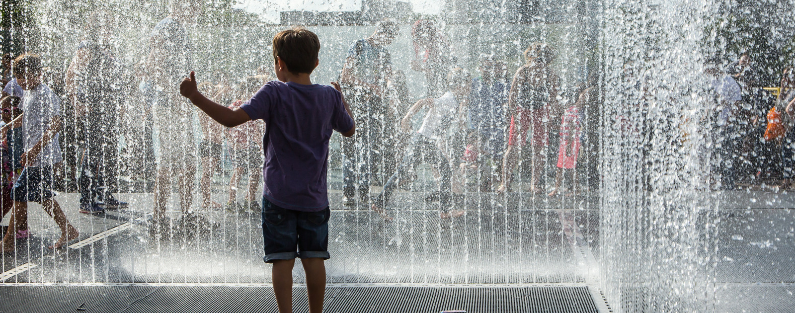 Children jumping in Jeppe Hein's Appearing Room Fountains