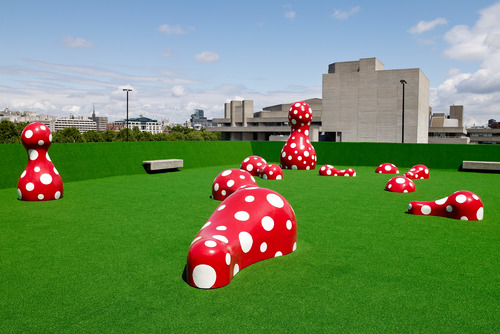 Red and White Spotted Scupltures by artist, Yayoi Kusama outside at The Hayward Gallery