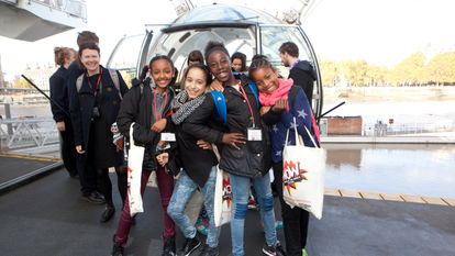 A group of Girls in front of the London Eye