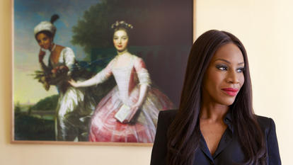Portrait of Amma Asante, the film Director of Belle movie, in front of the portrait of Dido Elizabeth Belle and her cousin Elizabeth inside Kenwood House