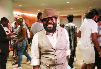 Man Smiling at Africa Utopia Member's Salon
