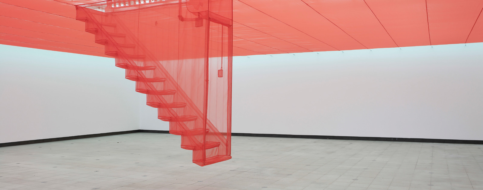 Red Textile Staircase by artist, Do Ho Suh at Hayward Gallery
