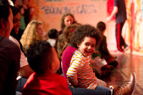 Young boy enjoying a performance during the Imagine Festival at the Southbank Centre