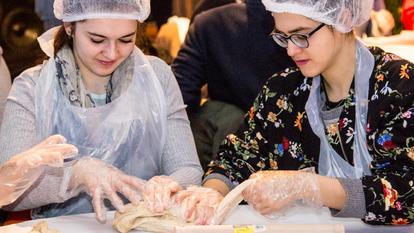 Women making cinnamon buns