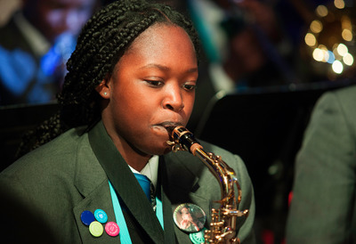 Young Girl Playing a Saxophone