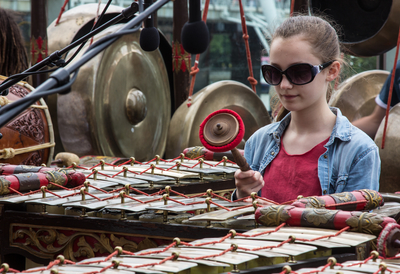 Girl in Sunglasses Playing the Gamelan