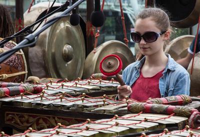 Girl in Sunglasses Playing the Gamelan