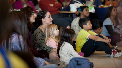 Families watching a puppet show