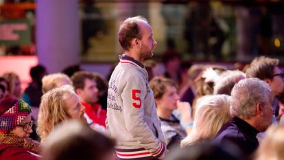 Audience Member Standing