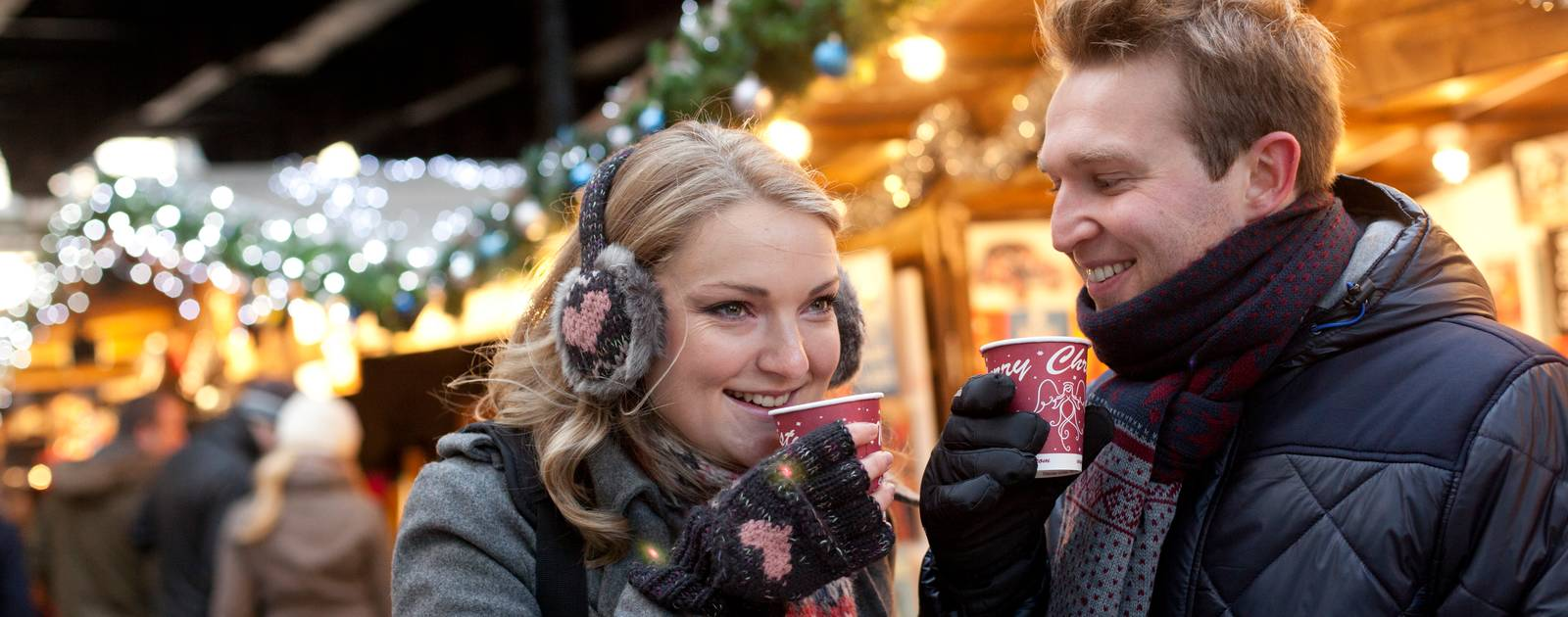 Couple enjoying mulled wine at the Winter Market, Southbank Centre