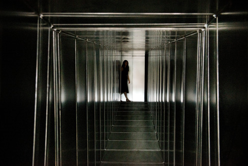 Girl at end of Metal Corridor installation by Carsten Höller in Hayward Gallery