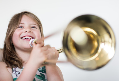 Little Girl Smiling with Trumpet