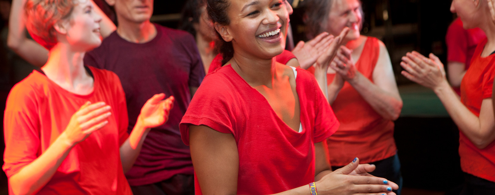 Girl dancing and smiling during a workshop at the Southbank Centre