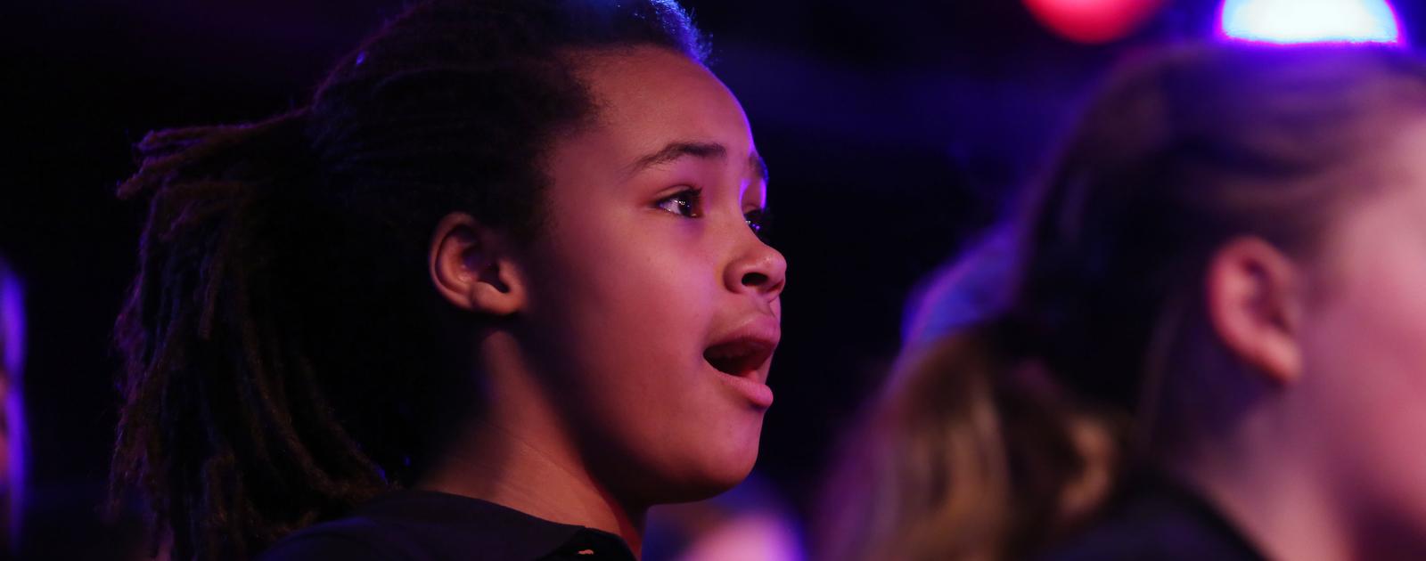 Young Girl Singing in Chorus