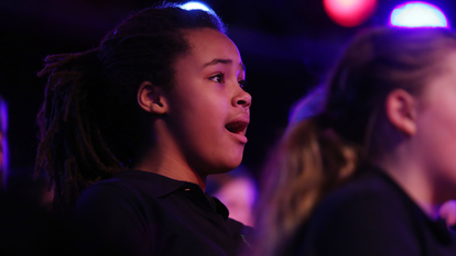 Young Girl Singing in Chorus