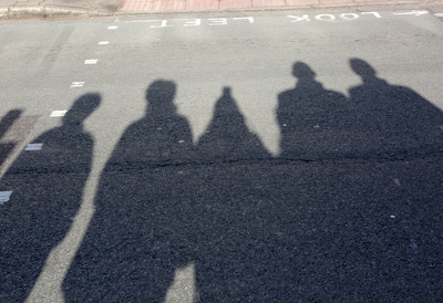 People's Shadows on a Road