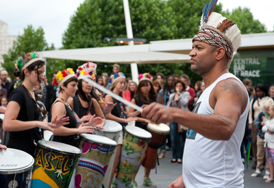 Man conducting drum line