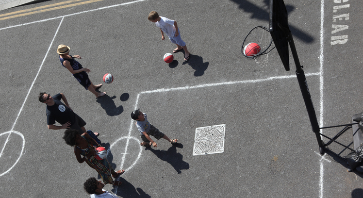 Photo of a pop-up basketball court and players, at Southbank Centre