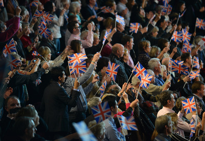 Audience Members waving British Flags