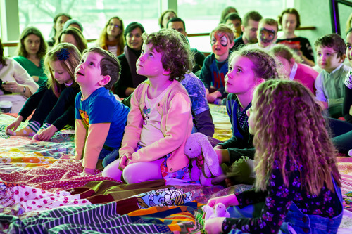 Children Listening on THE GIANT STORYTELLING BED at Imagine Children's Festival