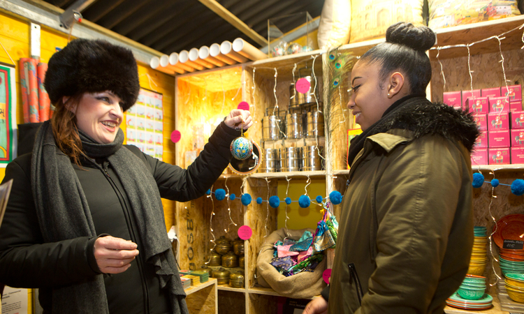 Two women at a Christmas stall